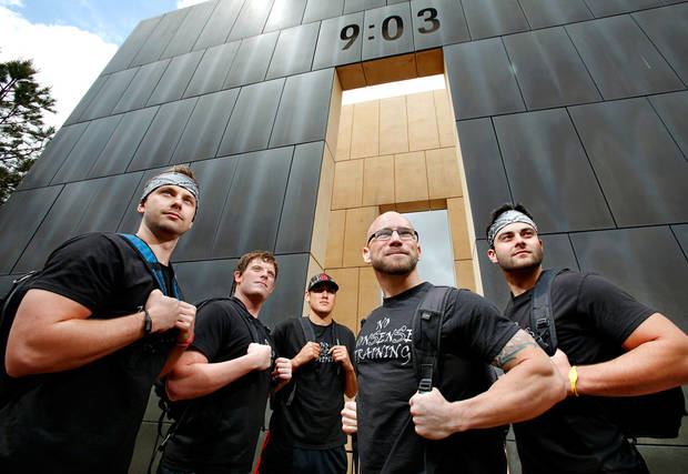 photo - These five men will participate in Sunday's Memorial Marathon carrying 168 pounds that will be distributed among their backpacks, symbolizing the 168 people who were killed in the bombing of the Oklahoma City Alfred P. Murrah Federal Building in 1995.  Posing with the west wall of the Memorial as a backdrop are, from left, Jake Adkins, Chris Murphy, John O'Toole, Sean Shearon and Eric Stanley on Wednesday, April 27, 2011  Photo by Jim Beckel, The Oklahoman ORG XMIT: KOD