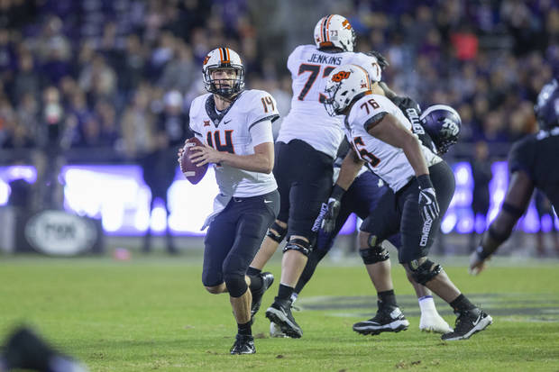 Oklahoma State quarterback Taylor Cornelius looks for a target during Saturday's game vs. TCU in Fort Worth, Texas. [PHOTO BY BRUCE WATERFIELD, Courtesy OSU Athletics]
