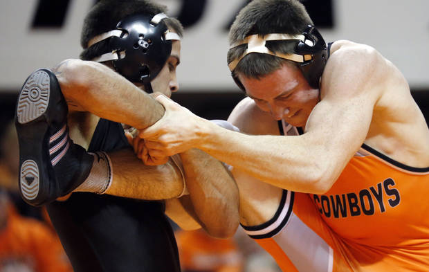 photo - COLLEGE WRESTLING: OSU's Jon Morrison wrestle Iowa's Tony Ramos during the wrestling dual between Oklahoma State University and Iowa at Gallagher-Iba Arena in Stillwater, Okla.,  Sunday,Nov. 3, 2013. Photo by Sarah Phipps, The Oklahoman