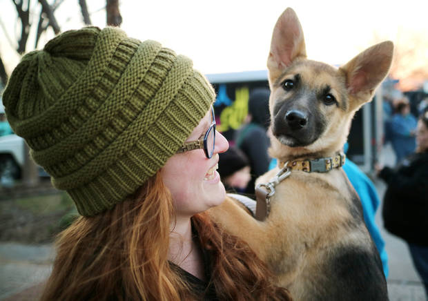 Jessica Freeman carries her German Shepherd puppy, Zoey, during Heard on Hurd in downtown Edmond on March 19. Photo by Doug Hoke, The Oklahoman