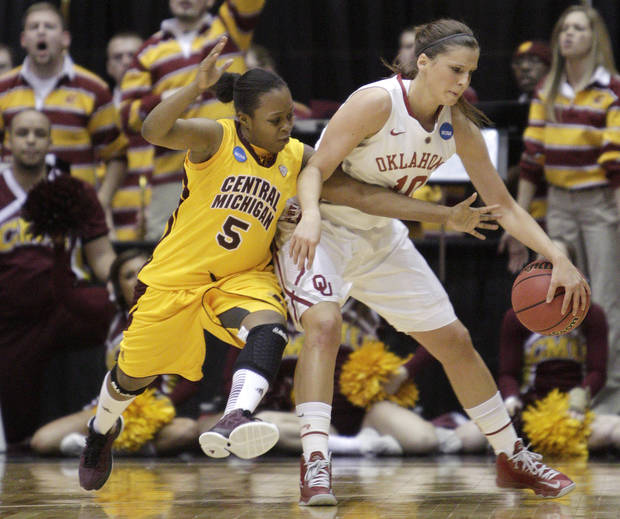 photo - Central Michigan's Jalisa Olive, left, tries to steal the ball from Oklahoma's Morgan Hook during the first half of a first-round game in the women's NCAA college basketball tournament Saturday, March 23, 2013, in Columbus, Ohio. (AP Photo/Jay LaPrete) ORG XMIT: OHJL104