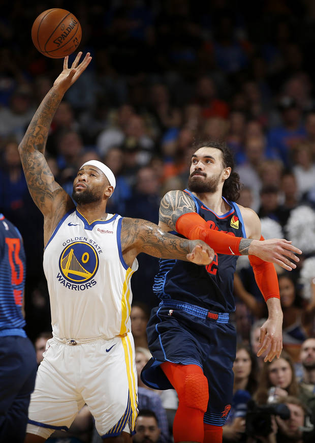 Steven Adams defends Golden State's DeMarcus Cousins in a Thunder-Warrior game last season. (Photo by Sarah Phipps)