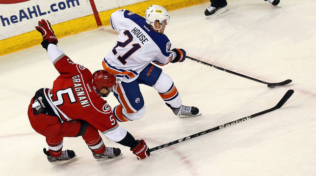photo - Oklahoma City's Tanner House (21) takes the puck past Charlotte's Marc-Andre Gragnani (5) during an AHL hockey game between the Charlotte Checkers and the Oklahoma City Barons at the Cox Convention Center in Oklahoma City, Friday, Feb. 1, 2013. Photo by Nate Billings, The Oklahoman