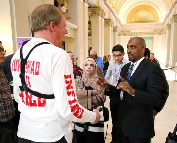 "Jim Gilles, a Pentacostal preacher from Evansville, Illinois, debates about Islam with Yusuf Webster and other Muslims at the third annual ""Muslim Day at the Capitol"" [Photo by Doug Hoke, The Oklahoman]"