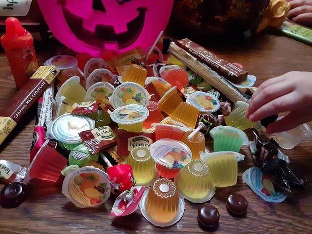 Kyla McDonnell, 4, daughter of Features Writer Brandy McDonnell, selects a Malaysian jelly from an assortment of international candies Instead of trick-or-treating during the pandemic, plan a family taste test with new delicacies. [Brandy McDonnell/The Oklahoman]