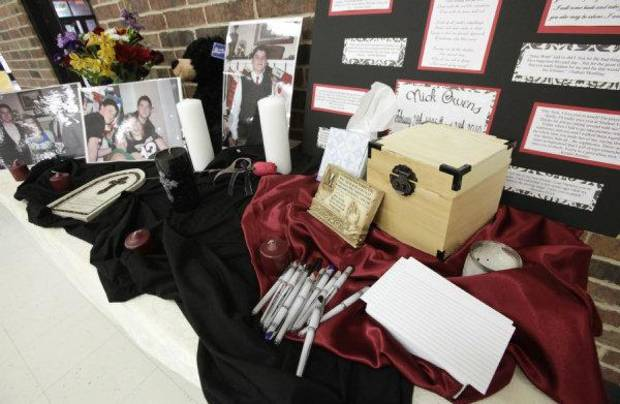 Pictures of Nick Owens and his family and a box for friends to share thoughts and prayers are part of a memorial at Putnam City North High School. The 15-year-old sophomore was killed Sunday in a traffic accident. PHOTO BY PAUL B. SOUTHERLAND, THE OKLAHOMAN  PAUL B. SOUTHERLAND - PAUL B. SOUTHERLAND