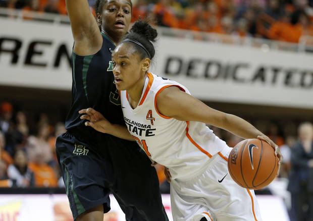 photo - Oklahoma State's Kendra Suttles (31) goes past Baylor's Brooklyn Pope (32) during a women's college basketball game between Oklahoma State University and Baylor at Gallagher-Iba Arena in Stillwater, Okla., Saturday, Feb. 2, 2013. Photo by Bryan Terry, The Oklahoman