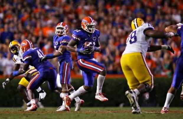 photo - University of Florida's Brandon Spikes intercepts the ball early in the fourth quarter during UF's home win against LSU.--(Brandon Kruse/ The Gainesville Sun)