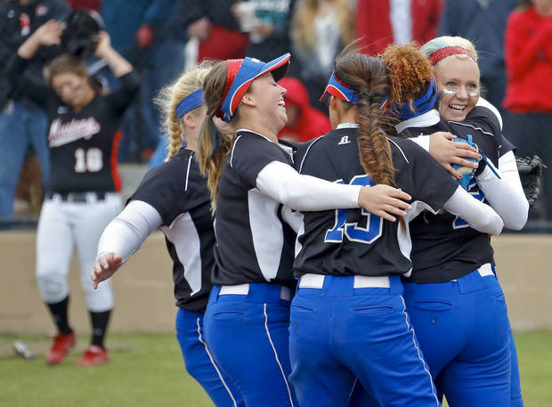 photo - Moore celebrates the win over Mustang during the Class 6A state semi final game between Moore and Mustang at the Ballfields at Firelake in Shawnee, Okla. on, Friday, Oct. 18, 2013.  Photo by Chris Landsberger, The Oklahoman