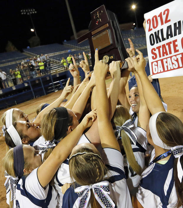 photo - The Edmond North Huskies celebrate with the championship trophy after winning the 6A state championship fast-pitch softball game against Moore at ASA Hall of Fame Stadium in Oklahoma City, Monday, Oct. 15, 2012. Edmond North won, 11-2. Photo by Nate Billings, The Oklahoman