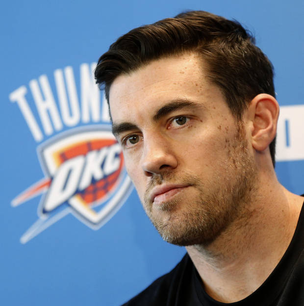 photo - Nick Collison listens to a question during exit interviews with the media for the Oklahoma City Thunder at the team's practice facility in Oklahoma City, Sunday, June 1, 2014. The Photo by Nate Billings, The Oklahoman