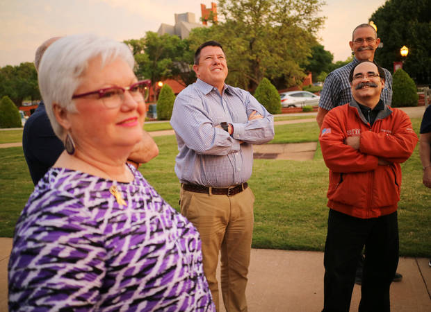 Dot Hill, Neil Arter and Ron Vega look at two survivor trees growing on Oklahoma Christian University's campus. The memorial has a sapling from the Oklahoma City Survivor Tree and a cutting from the 9-11 Survivor Tree in New York. [Photo by Doug Hoke, The Oklahoman]
