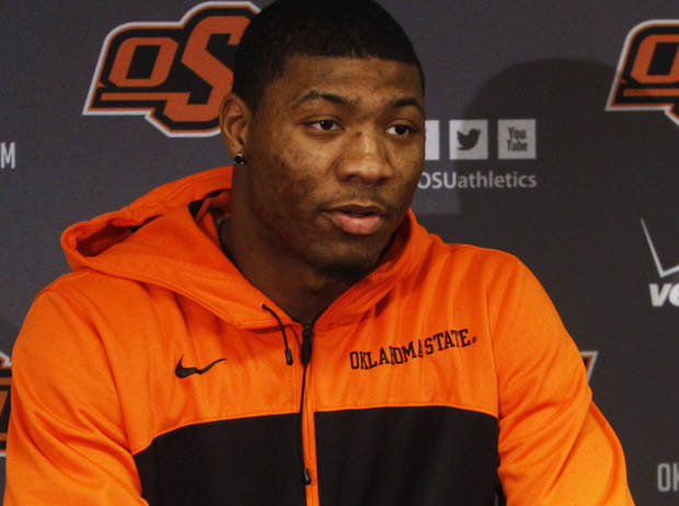 photo - As Joel Embiid's draft stock falls, Marcus Smart's stock keeps rising. Photo by KT King/The Oklahoman