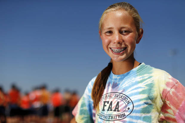 photo - Edmond North cross country runner Jaci Smith poses for a photo before practice at Edmond North High School in Edmond, Okla., Wednesday, Sept. 12, 2012. Photo by Nate Billings, The Oklahoman