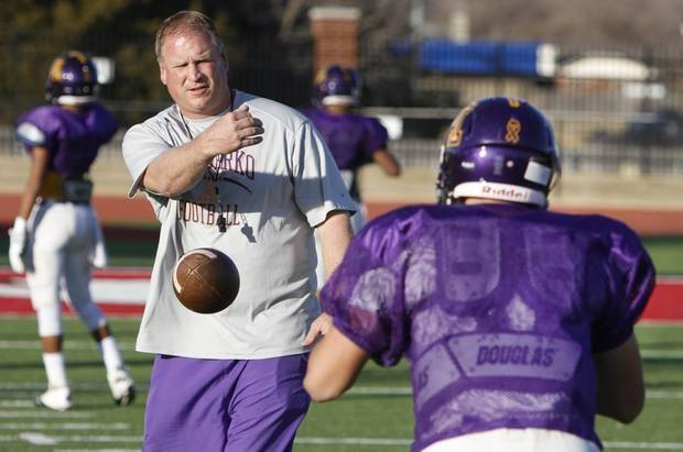photo - Anadarko football coach Kent Jackson puts his team through a workout at Yukon High School in Yukon, Tuesday December 3, 2013. Photo By Steve Gooch, The Oklahoman