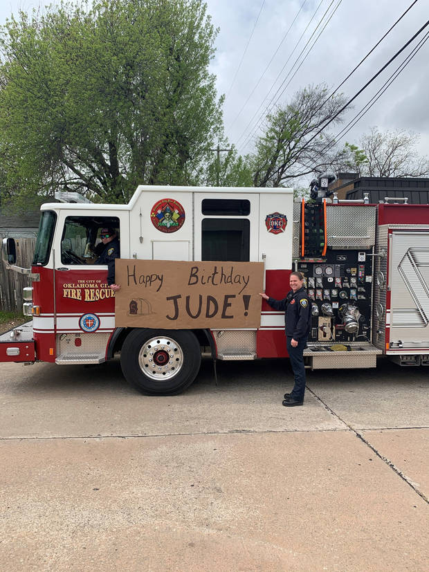 The birthday sign on the side of a fire truck.