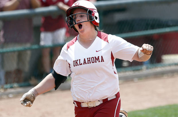 photo -                    OU's Brittany Williams celebrates a home run in the first inning of the Sooners' 11-3 Bedlam win over OSU on Sunday.                     Photo by Sarah Phipps, The Oklahoman