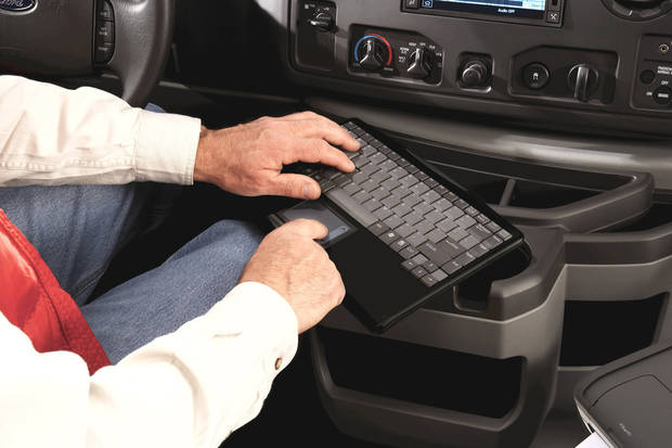 Left: The keyboard and in-dash computer turn a Ford truck into a mobile office, via a cellular broadband  connection.