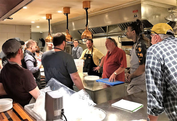 Chefs gather in the kitchen of The Hutch on Avondale before Sunday's 405 Fried Chicken Challenge. [Dave Cathey/The Oklahoman]
