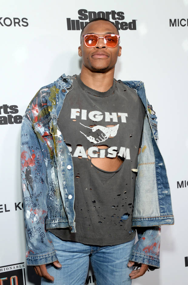 "Russell Westbrook sported a ""Fight Racism"" shirt at Tuesday's Sports Illustrated Fashionable 50 event. [PHOTO BY MICHAEL KORVAC/GETTY IMAGES FOR SPORTS ILLUSTRATED]"