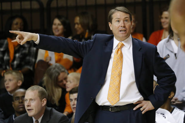 photo - OSU: Oklahoma State head coach Travis Ford argues a call during the college basketball game between Oklahoma State University and Portland State, Sunday,Nov. 25, 2012. Photo by Sarah Phipps, The Oklahoman