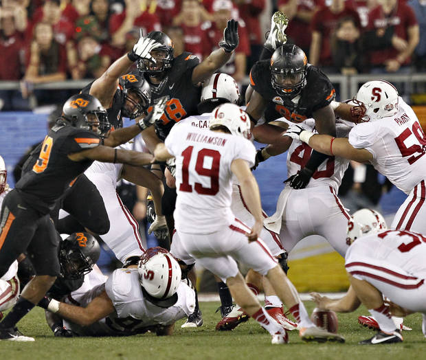 photo - Stanford kicker Jordan Williamson kicks and misses a field-goal attempt in overtime during the Fiesta Bowl. AP Photo