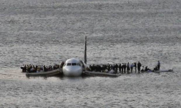 photo - Airline passengers wait to board a ferry to be rescued on the wings of a US Airways Airbus 320 jetliner that safely ditched in the frigid waters of the  Hudson  River in New York, Thursday Jan. 15, 2009 after a flock of birds knocked out both its engines. All 155 people on board survived. (AP Photo/Steven Day)