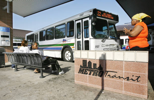 photo - Passengers wait for their bus at the Metro Transit Center, 420 NW 5, in downtown Oklahoma City Wednesday, May 24, 2006. By Paul B. Southerland, The Oklahoman