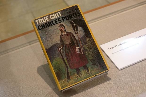 "A copy of the novel ""True Grit"" by Charles Portis is featured in the National Cowboy & Western Heritage Museum's exhibit ""Two Grits- A Peek Behind the Eyepatch,"" which explores the two different films made from the 1968 novel. [Photo by Doug Hoke/The Oklahoman]"