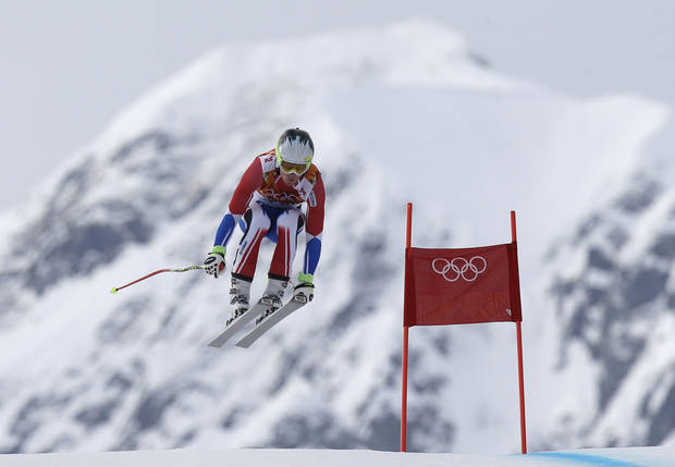 photo - France's Alexis Pinturault makes a jump during Men's super combined downhill training at the Sochi 2014 Winter Olympics, Tuesday, Feb. 11, 2014, in Krasnaya Polyana, Russia. (AP Photo/Luca Bruno)