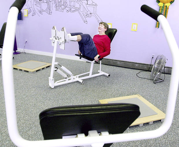 photo - A member of the Curves club works out in Hollis, Maine. In part because of the economy, Curves International deepened its discount for new members.AP PHOTO