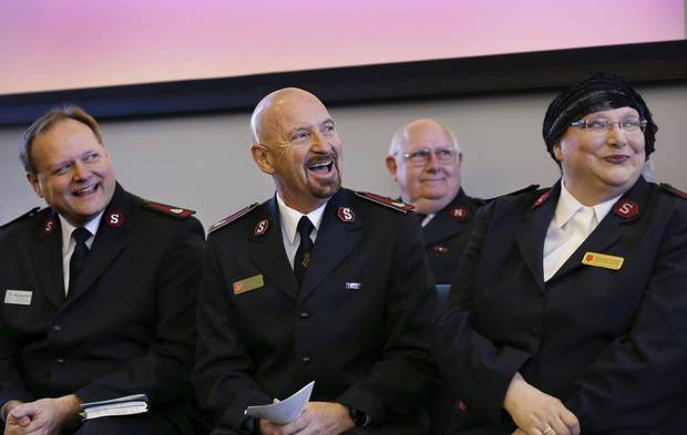 Salvation Army Maj. Charlotte Gargis, at right, listens to a speaker at the dedication of the new Salvation Army Center of Hope in Oklahoma City in November 2014. [Photo by Jim Beckel, The Oklahoman]