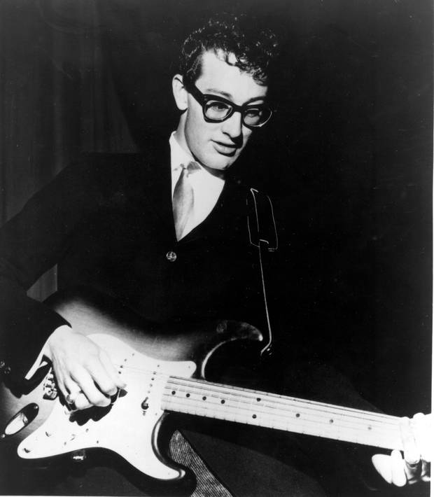 ** FILE ** American rock and roll singer Buddy Holly performs in the 1950s.  The diamond-studded watch Buddy Holly was wearing when he was killed in a plane crash has been sold at auction for $155,350. (AP Photo)