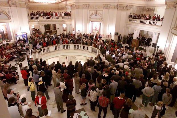 People gather for the 2001 Rose Day rally at the state Capitol. Photo by Doug Hoke, The Oklahoman]