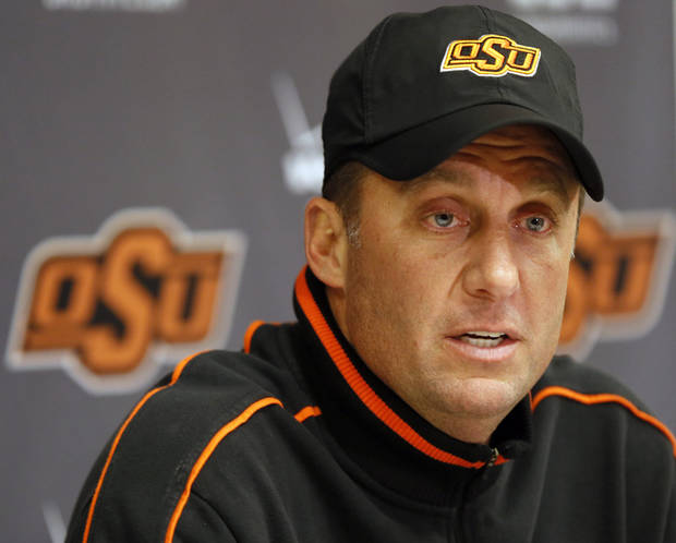photo - COLLEGE FOOTBALL:  OSU head coach Mike Gundy talks to the media after football practice at Oklahoma State University in Stillwater, Okla., Friday, Dec. 14, 2012. Photo by Nate Billings, The Oklahoman