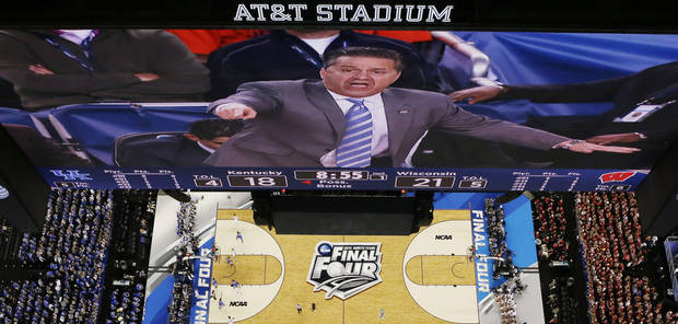 photo - Kentucky coach John Calipari is shown on the big screen at AT&T Stadium during his team's Final Four game against Wisconsin.                    AP photo