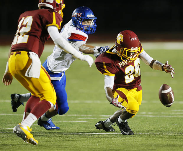 photo - Putnam City North's Larry Butler (26) fumbles the ball in front of Moor's Will Sprayberry (5) and next to teammate John Simon (12) during a high school football game between Putnam City North and Moore at Putnam City Stadium in Oklahoma City, Thursday, Sept. 27, 2012. Moore recovered the fumble. Photo by Nate Billings, The Oklahoman