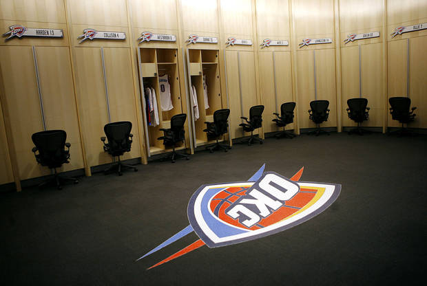 photo - The new Oklahoma City Thunder locker room features a dining-table-size, marble terrazzo Thunder logo in the middle of the floor. PHOTO BY JOHN CLANTON, THE OKLAHOMAN