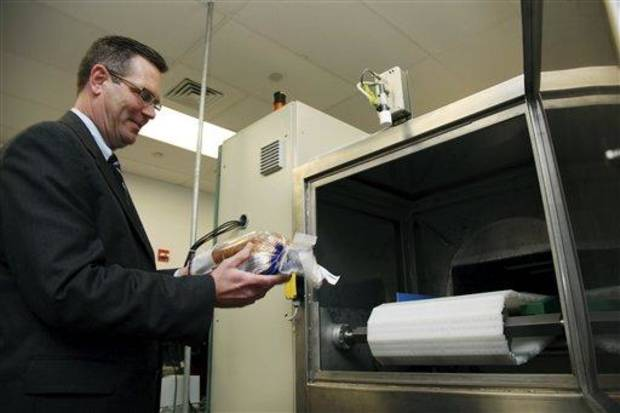 photo - In this Dec. 6, 2012, photo, Don Stull, chief executive officer of Microzap, Inc., places a loaf of bread inside a patented microwave that kills mold spores in Lubbock, Texas. The company claims the technology allows bread to stay mold-free for 60 days. (AP Photo/John Mone)