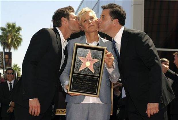photo - Talk show host and comedian Ellen DeGeneres, center, is kissed by Ryan Seacrest, left, and Jimmy Kimmel at her Hollywood Walk of Fame star ceremony on Tuesday, Sept. 4, 2012, in Los Angeles. (Photo by Chris Pizzello/Invision/AP)