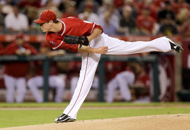 photo - Los Angeles Angels relief pitcher Garrett Richards throws against the Oakland Athletics during the first inning of a baseball game in Anaheim, Calif., Monday, Sept. 23, 2013. (AP Photo/Chris Carlson)