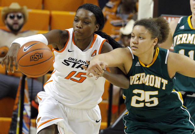photo - Oklahoma State's Toni Young (15) fights for Vermont's Kaylea Britton (25) for a loose ball during the women's college basketball game between Oklahoma State University and Vermont at Gallagher-Iba Arena in Stillwater, Okla., Sunday,Dec. 16, 2012. Photo by Sarah Phipps, The Oklahoman