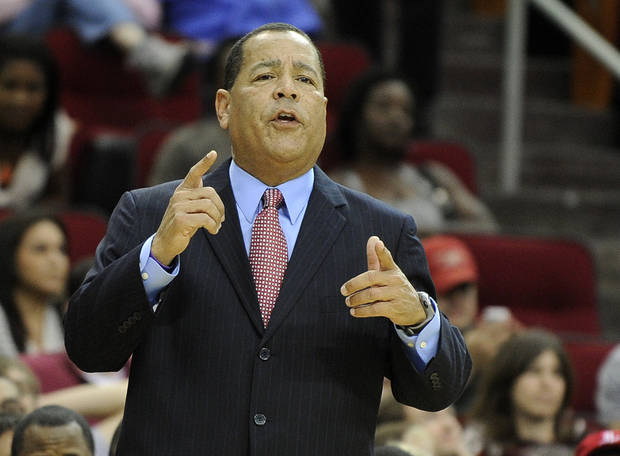 photo - Houston Rockets assistant coach Kelvin Sampson directs the players in the first half of an NBA basketball game against the Detroit Pistons on Saturday, Nov. 10, 2012, in Houston. Sampson is handling coaching duties until head coach Kevin McHale returns from family business. (AP Photo/Pat Sullivan)