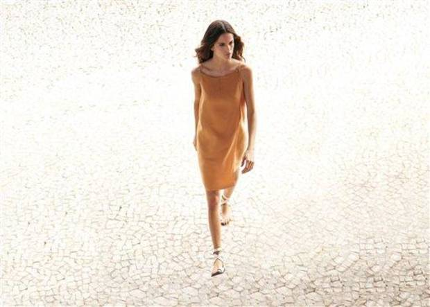 photo - In this undated image released by Calvin Klein, a model wears a dress by Francisco Costa for Calvin Klein, part of a limited collection available at Macy's. (AP Photo/Calvin Klein, Cliff Watts)