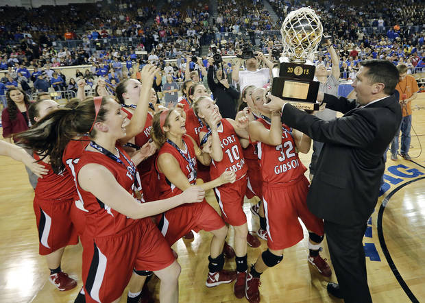 photo - Fort Gibson celebrates with the gold ball trophy after the win over Mount Saint Mary during the state high school basketball tournament Class 4A girls championship game between Fort Gibson High School and Mount St. Mary High School at the State Fair Arena on Saturday, March 9, 2013, in Oklahoma City, Okla. Photo by Chris Landsberger, The Oklahoman