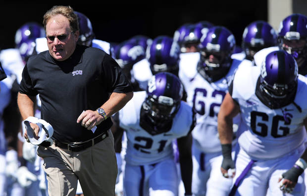 photo - TCU head coach Gary Patterson leads his team onto the field for an NCAA college football game against Air Force, Saturday, Sept. 10, 2011, in Falcon Stadium at Air Force Academy, Colo. (AP Photo/ Kevin Kreck) ORG XMIT: COKK107