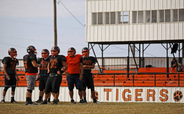 photo - HIGH SCHOOL FOOTBALL: Wellston football players wait for the play during practice on Wednesday, October 10, 2012. Photo by Bryan Terry, The Oklahoman