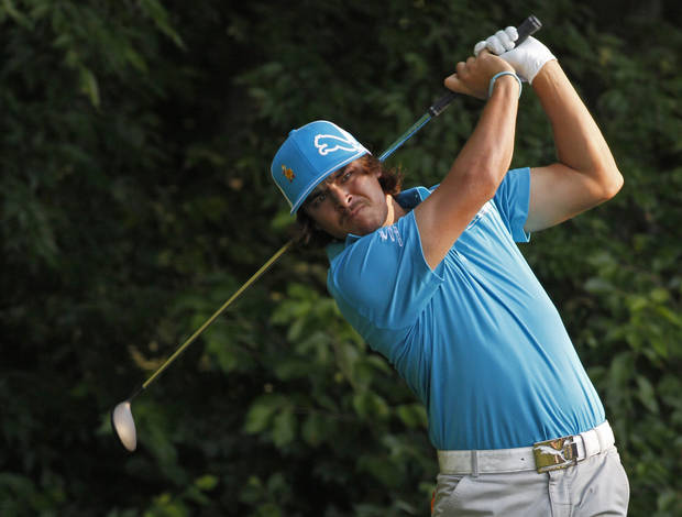 photo -   Ricky Fowler watches his tee shot on the fifth hole during the first round of the Wells Fargo Championship golf tournament at Quail Hollow Club in Charlotte, N.C., Thursday, May 3, 2012. (AP Photo/Bob Leverone)