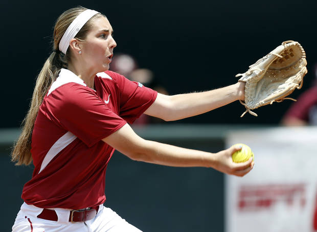 photo - OU's Kelsey Stevens (18) pitches during the final game of the Norman Regional in 2014 NCAA softball championship between Oklahoma and Texas A&M in Norman, Okla., Sunday, May 18, 2014. OU won 11-6. Photo by Nate Billings, The Oklahoman