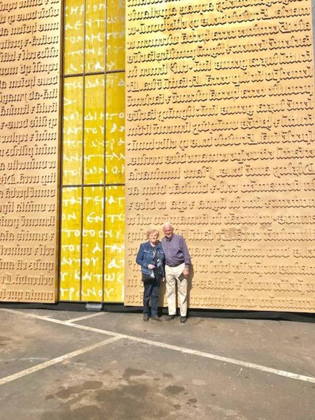 Inez and Chuck Freeman of Bethany pose for a picture in front of the Museum of the Bible's Gutenberg Gates replica at Penn Square Mall on Saturday, Oct. 29, in Oklahoma City. [Photo by Carla Hinton, The Oklahoman]